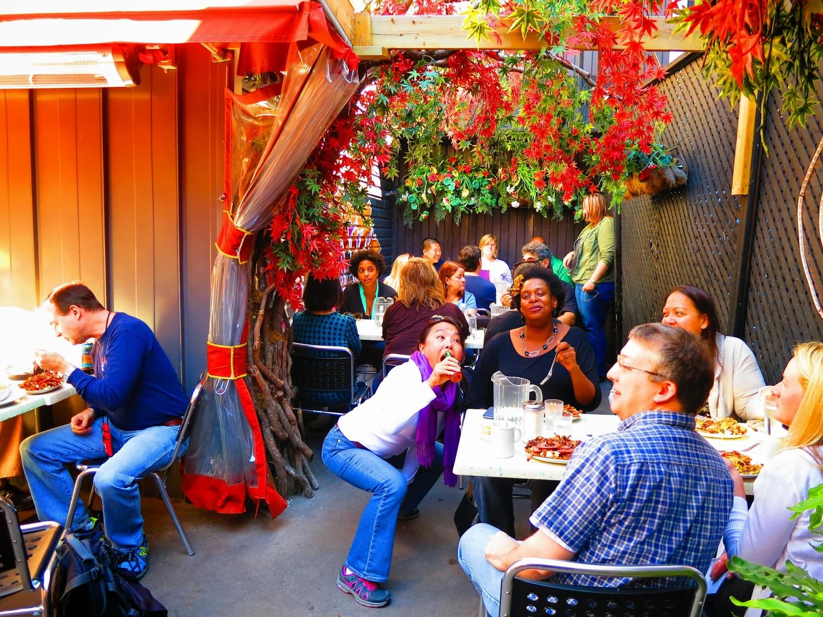 people enjoying poutine on terasse