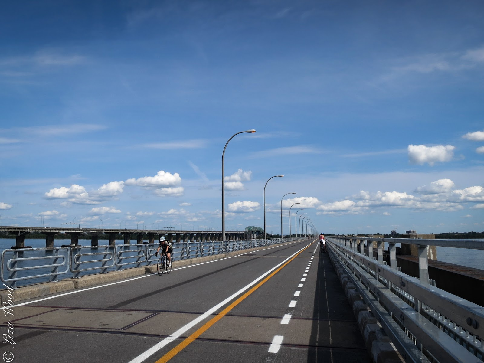Cycling along bridge over St. Lawrence River