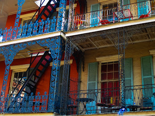 Beautiful, colorful wrought iron balconies in the French Quarter of NOLA