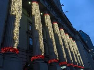 Christmas lights drape columns