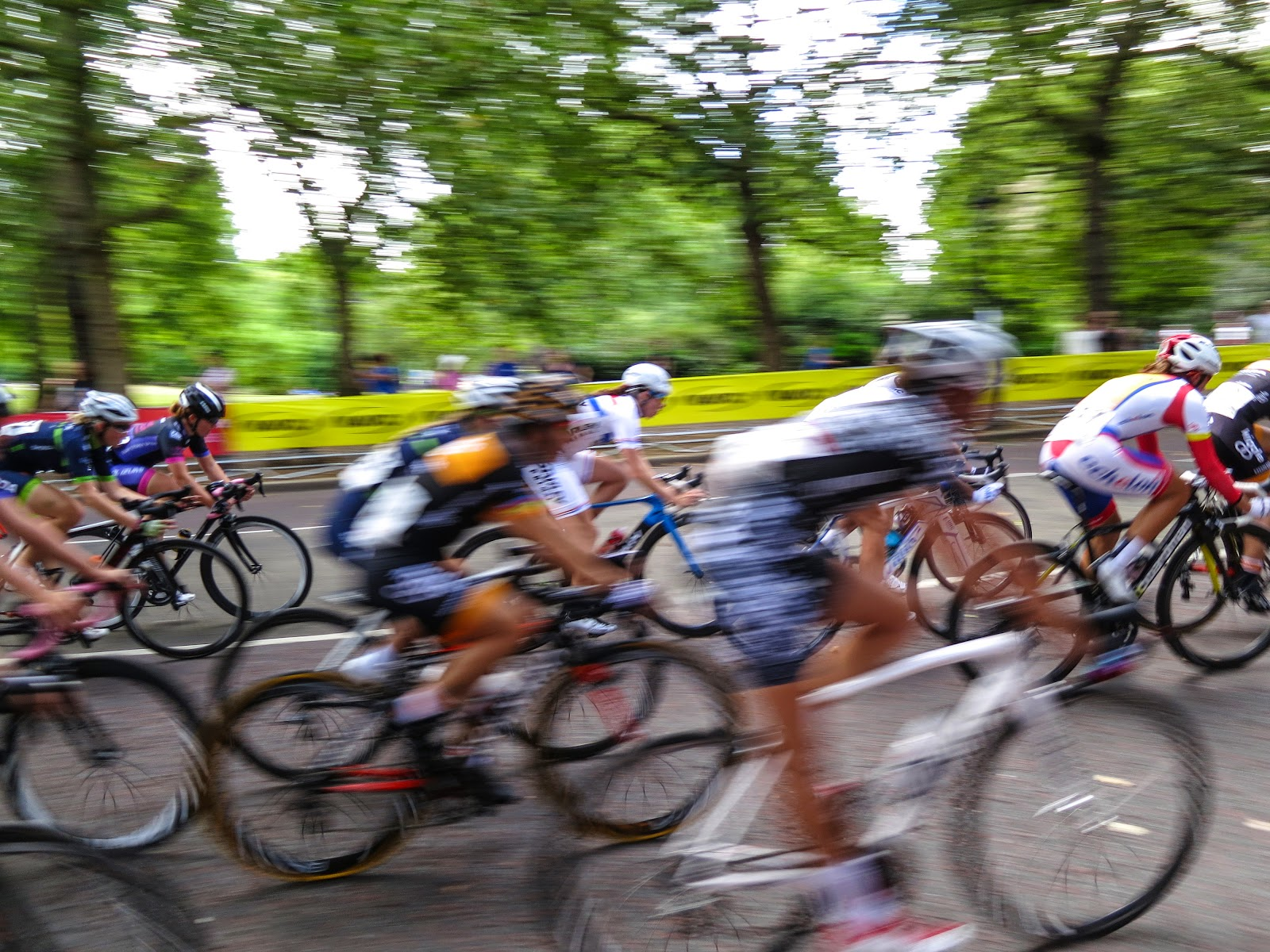 Competitive cyclists race down street