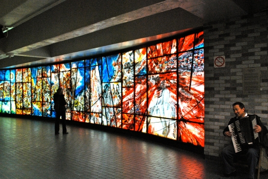 Accordian player and stained glass art at place des arts metro