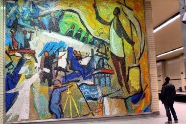Man admiring mosaic at Sherbrooke metro