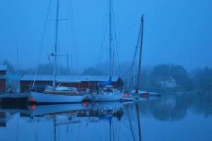 Marina in the blue evening mist